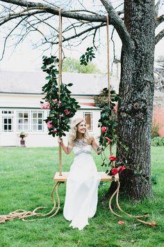bride on garden swing // photo by Erin + Tara // http://ruffledblog.com/garden-party-bridal-shoot