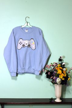 Level-up the way you game with hearts and stars! This take on a familiar controller shape will take you all the way to the Final Boss and beyond! ヾ(o✪‿✪o)シ  #videogame #gamer #sweatshirt #kawaii #holographic #fashion #design