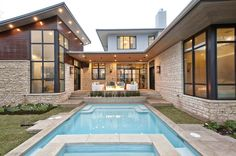 modern stone placqued home Contemporary Texas Residence Combines Antique Touches With Cool Blue Accents