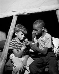 """Splint in a Tent: August Southfields, New York. """"Interracial activities at camp Nathan Hale, where children are aided by the Methodist Camp Service. First aid."""" Photo by Gordon Parks for the Office of War Information."""