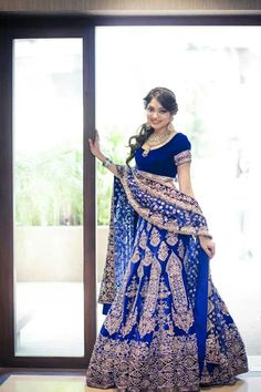 Real bride Rakhee Jain in lehnga by Manish Malhotra. Traditional Indian bride wearing a blue bridal lehenga