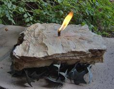 How to make your own rock candle...what a great way to display your beach stones you've collected on your ventures!