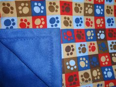 Cozy Baby Quilt with cute multi-color paw by DesertDreamersDesign.  Great for ANY dog lover OR the dogs!