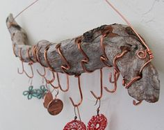 "Recycled Redwood Driftwood Hanging Jewelry Stick Display. - has ""native"" feel, and looks easy to make.  also, penny earings are a great idea."