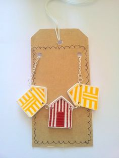 Beach hut bunting  necklace, shrink plastic , illustrated beach huts. £12,00, via Etsy.