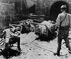 Bodies of Chinese victims under the gaze of a Japanese soldier, Nanking, December 1937
