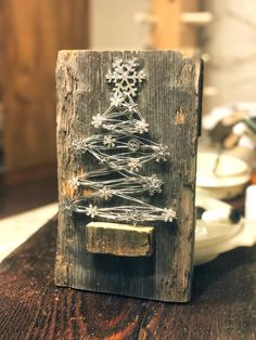 Little wire christmas tree with snowflake sewed on