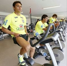 Brazil's Thiago Silva (L) is pictured next to teammates Paulinho (C) and David Luiz during a physical test in Teresopolis, near Rio de Janeiro May ♥ Brazil Team, World Cup 2014, Gym Equipment, Vogue, Bike, Sports, Thiago Silva, Rio De Janeiro, Brazil