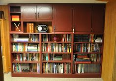 """My husband, Gary, built this wall-sized bookshelf, but we need more room already!"""