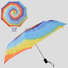 """This super groovy collapsible tie dye umbrella is sure to brighten any rainy day! Featuring a twisted spiral of colorful tie dye, this umbrella collapses to about 12"""" and comes with a matching protective cover."""