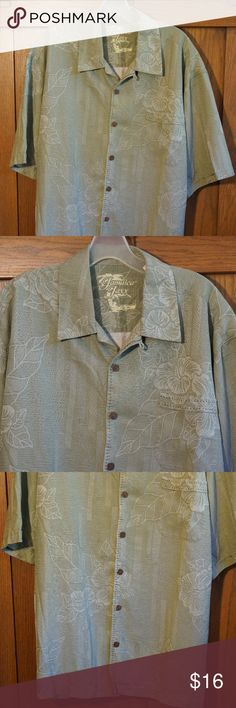JAMAICA JAXX Mens Silk Island Style SS Shirt Jamaica Jaxx Silk shirt.  7-Button front, 1 chest pocket. Lt Green/Gray, Tropical Floral print.  100% Silk, GUC.     Size XL                               (J152) MEASUREMENTS (inches): Chest (Armpit to Armpit): 23 Length (Shoulder to the bottom hem): 30 Jamaica Jaxx Shirts Casual Button Down Shirts