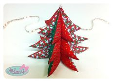 """""""Use up your Christmas fabric scraps to sew this 3D Christmas tree. This three-dimensional patchwork Christmas tree can stand up by itself to be displayed on a shelf, or you could add a ribbon to the top and hang it up."""""""