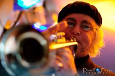 A jazz trumpet player performing live in a quaint little restaurant in Melbourne.