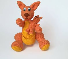 Crocheted kangaroo with a baby kangaroo.  This cute and funny mummy kangaroo with her baby will become your child's good friends. It is very interesting to play with them. You can move the mommy's forelegs and hind legs. It can sit and stand leaning on its tail. The baby is comfortably placed into the mummy's pouch. Such a set of crocheted kangaroos will make a perfect present to a child for any celebration. The mummy is 20 cm (7.87'') tall (sitting). The mummy is 24 cm (9.45'') tall…