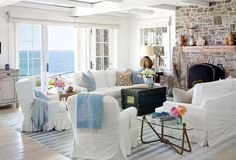 White furniture, stone fireplace, water view...I love this room!  #home #design