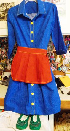Here's the costume I sewed for my Hug-a-Bug-a-Boo Children's Music Video, filmed in March, 2013.  My producer, Alison Myers, helped me pick out the pattern and fabric. I designed the apron!