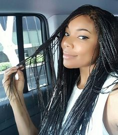 BRAIDED BEAUTY!!  Look who looks perfect in plaits! Gorgeous Gabrielle Union, usually sporting her signature loose wave look is rocking some serious micro braids that are nothing short of dope. We're especially loving how ends are left loose to give the coif even more movement and acts as a textural counterpoint to the pretty braids.