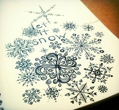 Black and white sketchbook drawing of snowflakes in ink. Art by Shalom Schultz Designs.