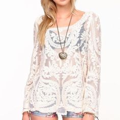 Crochet Lace Top White crochet lace top. Sheer and lace design. Fits like a small. Tops