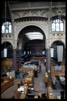 Amazing interior of the Birmingham Central Library, UK: built in 1882, after a fire destroyed the original building (1865-79). Demolished in 1974. This view is now looking through the large archway into an extra room that was constructed at right angles to Ratcliff Place. A view from the extention beyond the large archway back into looking back towards the reading room.