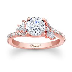 14KT Rose Gold Barkev's Diamond Engagement Ring with 0.64 ct in Round and Marquise Diamonds 7908LPW - Simply elegant describes this rose gold diamond engagement ring.   Featuring a prong set round diamond center graced on each side with a  flare of marquise diamonds and round diamonds cascading down the dainty  shank  for a touch of sheer elegance. Ring can also be ordered with a Moissanite Center Stone. Moissanite Center Stone Education: Moissanite is a lab-grown gemstone ...