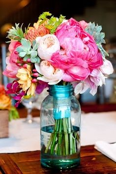 Beautiful flowers in a simple arrangement always are stunning and make me smile.