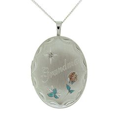 "TOC Sterling Silver ""Grandma"" Crystal Set Oval Locket Necklace 18"". The Olivia Collection presents this elegant hinged oval locket, which is engraved with ""Grandma"", crystal set and designed with a pink rose. It opens to reveal two spaces for those special photos, it is the perfect way to keep your loved ones close to your heart at all times. The sterling silver locket measures 31mm x 20mm approx. (including the bale) and it comes on an 18 inch sterling silver chain. Chain stamped 925…"