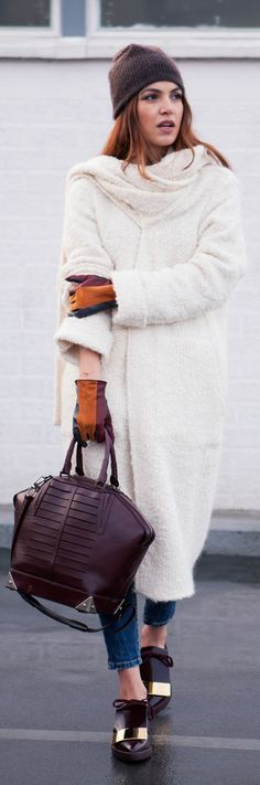 Negin Mirsalehi is wearing a white coat and jeans from Zara, top and brown hat from Filippa K, bag from Alexander Wang and the shoes are from Marni
