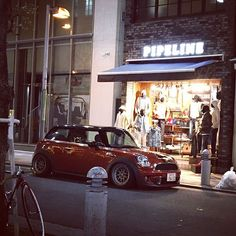 """Osaka street #r56 #mini #1552 #fifteen52 #coopers #アメ村 #sankakukoen #osaka #やはりミニは街が似合う(´ー`) #怖い車沢山通る#stancemini #stancenation #stanced #ilest #flash…"""