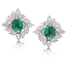 Harry Winston (circa 1950) - A Pair of Emerald and Diamond Earrings.