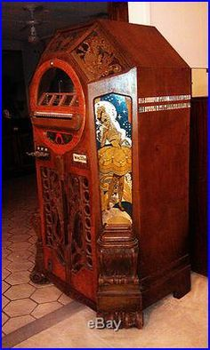 This jukebox is not only for musical entertainment, but the art on the body of the jukebox is one of a kind. (Wurlizer Model 42 Vicotory Jukebox) #unique #vintage #jukebox #woodwork