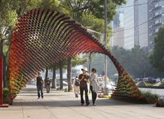 Mexico city, the 'portal of awareness' by rojkind arquitectos is a public space that is experienced spatially and while in motion. This structure attaches 1,497 handled mugs inside of a diagonal mesh of the steel rods, casting dynamic shadows on the sidewalk.