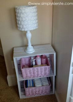 Love these cute baskets tucked into crates as a bedside table.