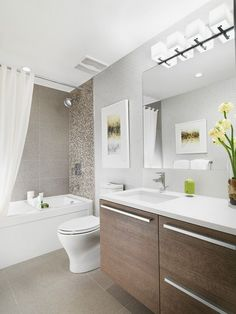 """Porcelain 12""""x 24"""" floor tiles and wall tile for tub surround and shower wall, Premium Kohler fixtures, low flow/dual flush #Kohler toilet with quiet-close seat, luxurious Kohler soaker tub, enclosed glass shower in select ensuites, soothing and energy efficient low flow/pressure balancing showerhead"""