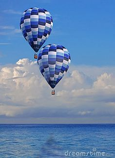 Two Peaceful Floating Hot Air Balloons by MorganOliver, via Dreamstime
