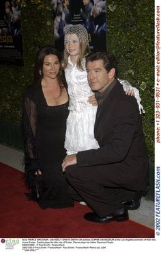 Actor PIERCE BROSNAN & wife KEELY SHAYE SMITH with actress SOPHIE VAVASSEUR at the Los Angeles p...
