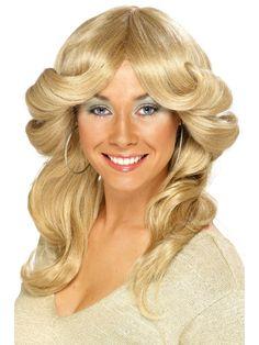Vaalea 70-luvun peruukki. Vaalea, laineille kiharrettu 70-luvun peruukki sopii retroilevalle kotirouvalle kuin patalappu käteen eikä tämä hiustyyli näytä yhtään hassummalle retrodiscon tanssilattiallakaan!