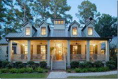 A storybook cottage wants a palette of earthy tones as creams, browns, rusts and other colors that tie the house to the ground. Whether introduced in the landscaping or as accents in the architecture, these colors keep the house from… Continue Reading → Style At Home, Front Porch Columns, House Columns, Brick Porch, Brick Columns, Southern Homes, Southern Front Porches, Southern Charm, House Goals
