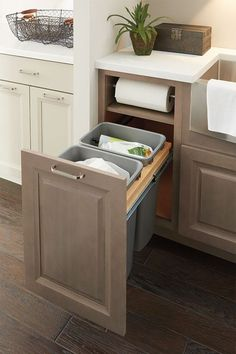 Kitchen cabinet base with paper-towel roll holder built in - this is huge!