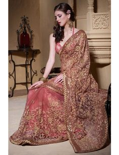 Beautiful dusty peach net Saree with heavy pallu, by http://www.BharatPlaza.in/womens-wear/best-of-our-collections/impressive-heavy-pallu-saree-bspt411.html with sparkling sequins, shimmering resham embroidery Rs4332 $70 Code: BSPT411