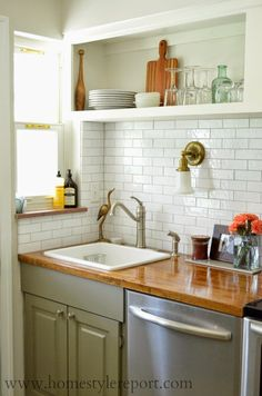 subway tile, butcher block counters, deep sink, stainless steel appliances...love it.