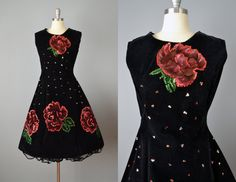 Made in Mexico in the 1950s, this black velvet dress features hand painted and sequined roses, a full A-line skirt, and a metal back zipper.