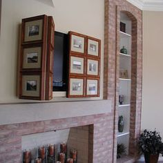 tv fireplace. Love the frames a way to cover up a TV in a cute way!