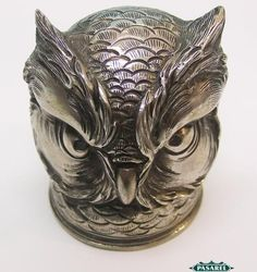 Unusual novelty silver owl head stirrup cup, c. 1900