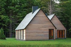 These cedar-clad dwellings for music residents in Marlboro, Vt., take an iconic house form and update it with minimal detailing and a palette of local materials.