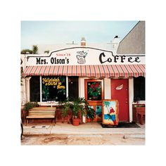 "Mrs. Olson's Coffee Hut — Oxnard, CA    Park your bike by the berms of sand blown from Hollywood Beach down the street. Sit at the counter — always the counter — among the regulars from the Navy base. Ask for the home fries, the thick ones grilled all morning in paprika, garlic salt, Parmesan cheese, and probably some other stuff. On summer Sundays, sing along as Brim, the owner, leads the whole packed Hut in a chorus of ""God Bless America."" It won't seem weird at all."