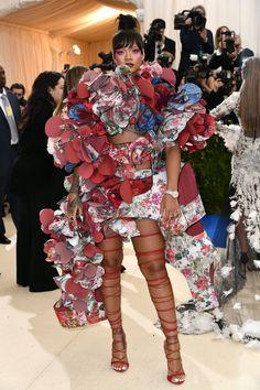 Rihanna in a Comme des Garçons dress and Rihanna Loves Chopard jewelry