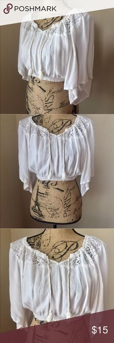 Hollister BOHO Crop Top Lace Embroidered Peasant This Hollister Crop Top is in great, beloved condition. It is a size Small, and still has plenty of life left. It is embroidered all around the neck from front to back. Has two small strings at the front to tie together for added style. Perfect for any spring/summer occasion! Hollister Tops Crop Tops