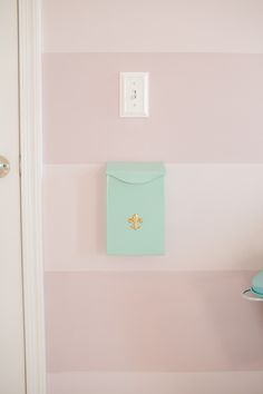 Don't forget the small touches! This mom placed a sweet mailbox in the nursery so they could leave messages and mail for the child as they get older. #Nesting
