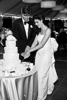 Bride and groom cut their wedding cake at The Castle Hill Inn. #cake #cakecutting #wedding #reception #blacktie #weddingcake #weddingphotography #destinationweddingnewport